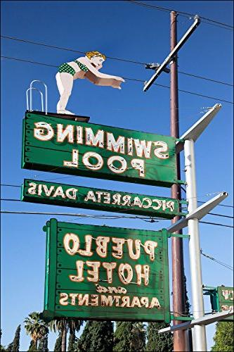 contemporary neon sign woman diving