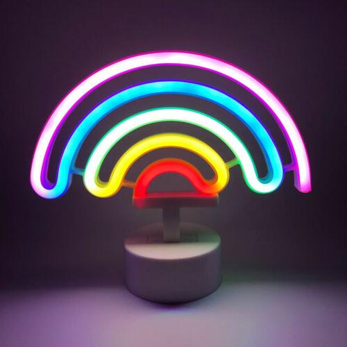 rainbow neon light sign with base night